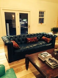 Michelle found this teal leather Chesterfield sofa on clearance as a floor sample. Score!