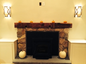 Millstone Masonry built this extraordinary rustic stone fireplace surround. The mantel is a reclaimed beam from the original structure.